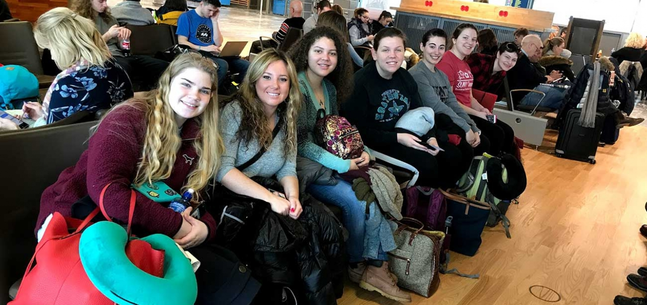 Students at the airport headed for Singapore
