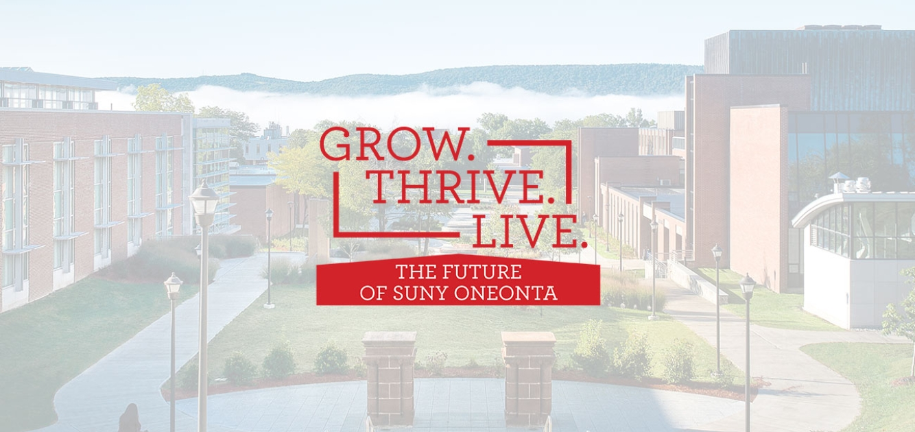 View of quad with Grow. Thrive. Live logo