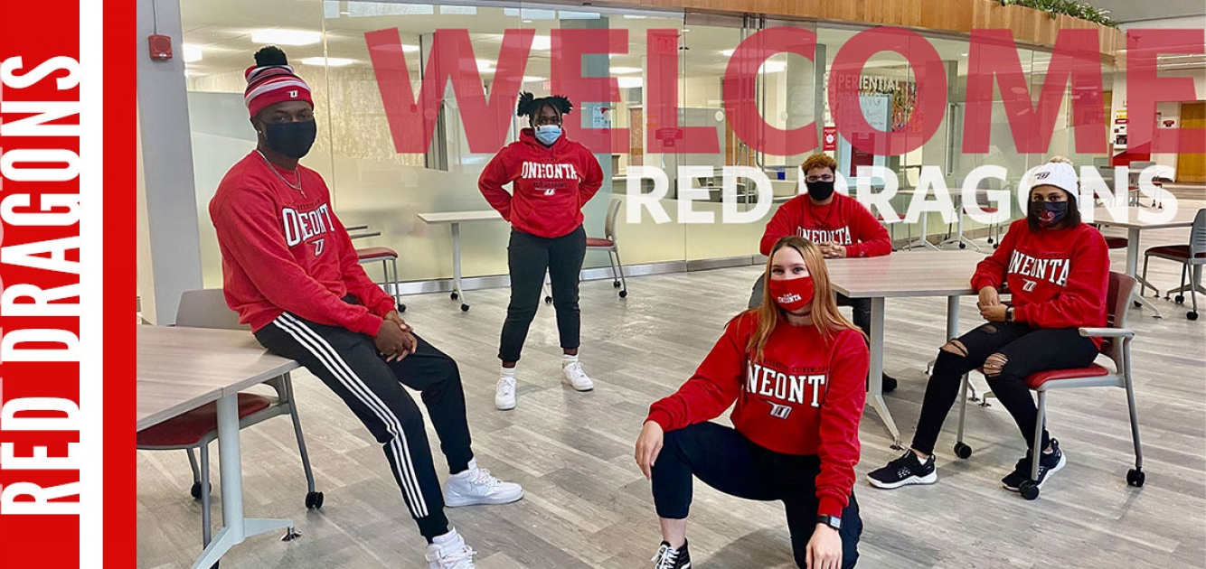 Students in red social distancing and wearing masks