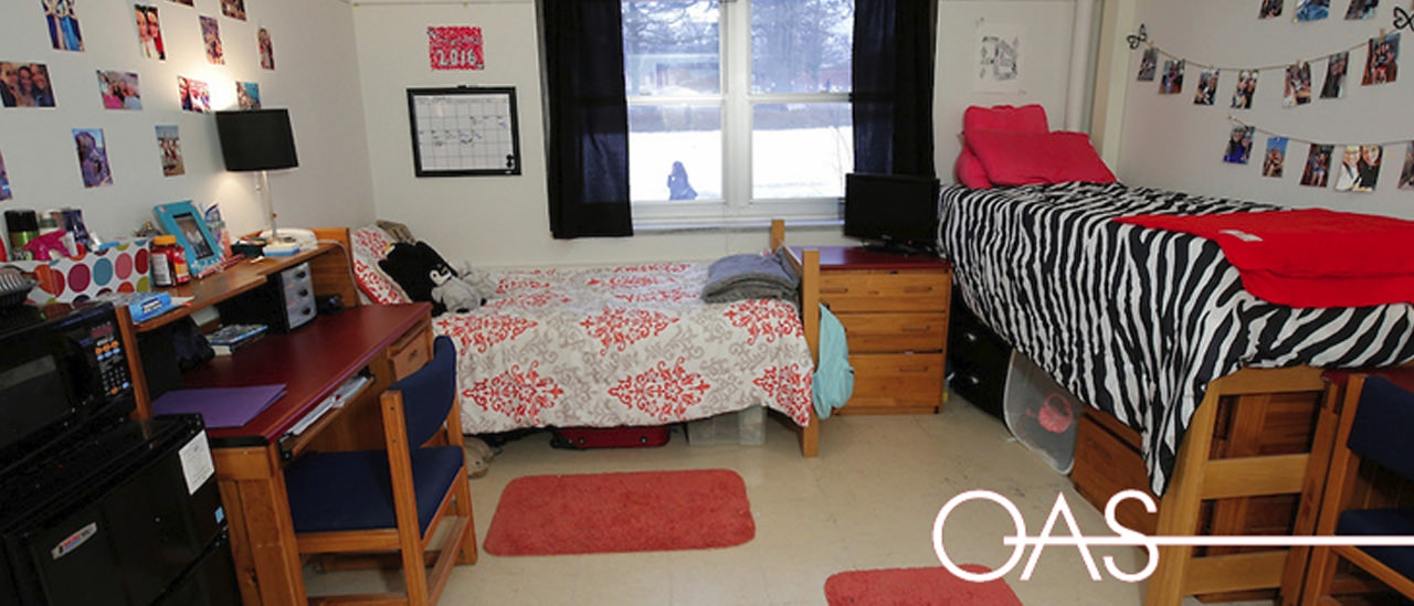 Comfy looking dorm with two beds