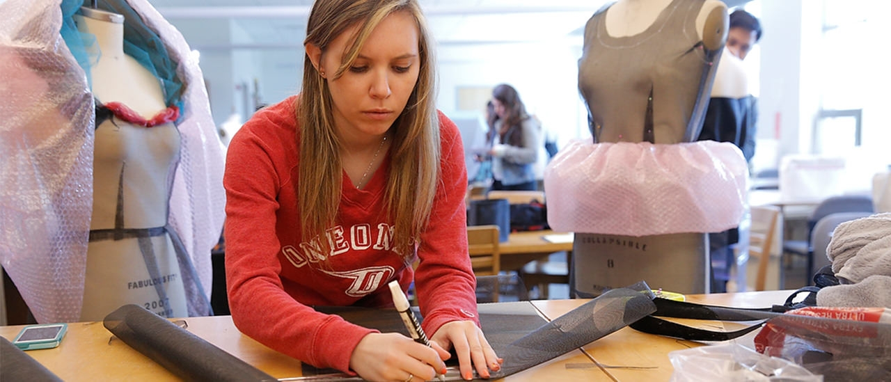 SUNY Oneonta student in a fashion design class