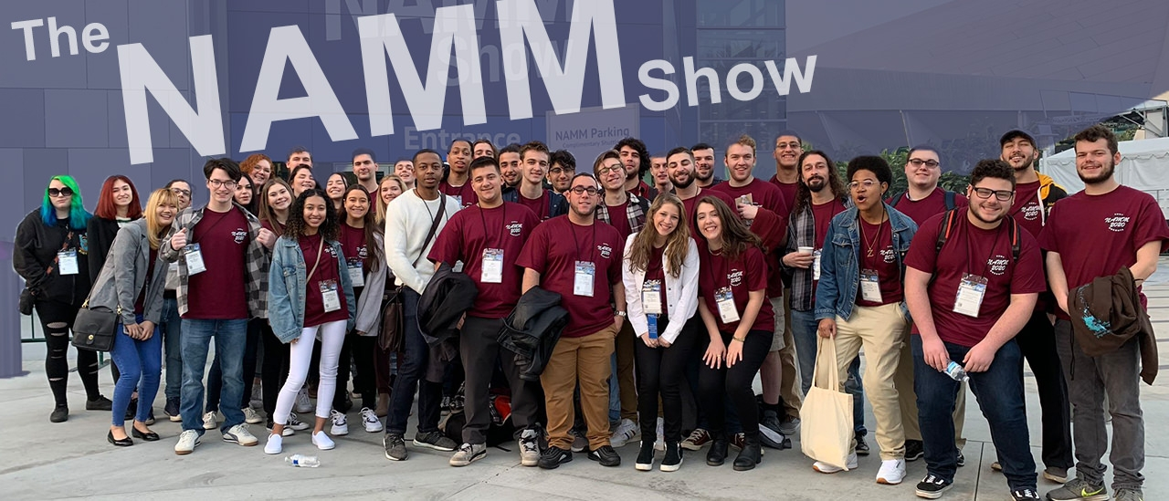 Students in front of NAMM Show sign