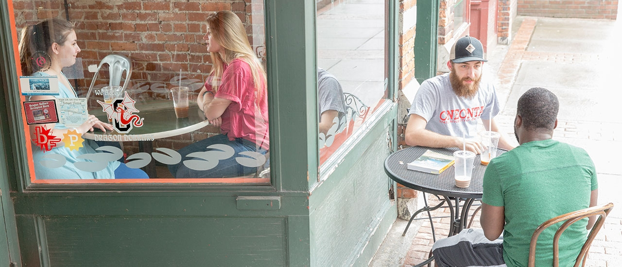Students eating inside and outside of Latte Lounge on Main Street