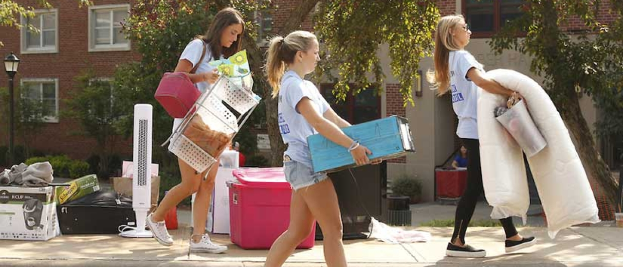 Students carrying goods on move in day.