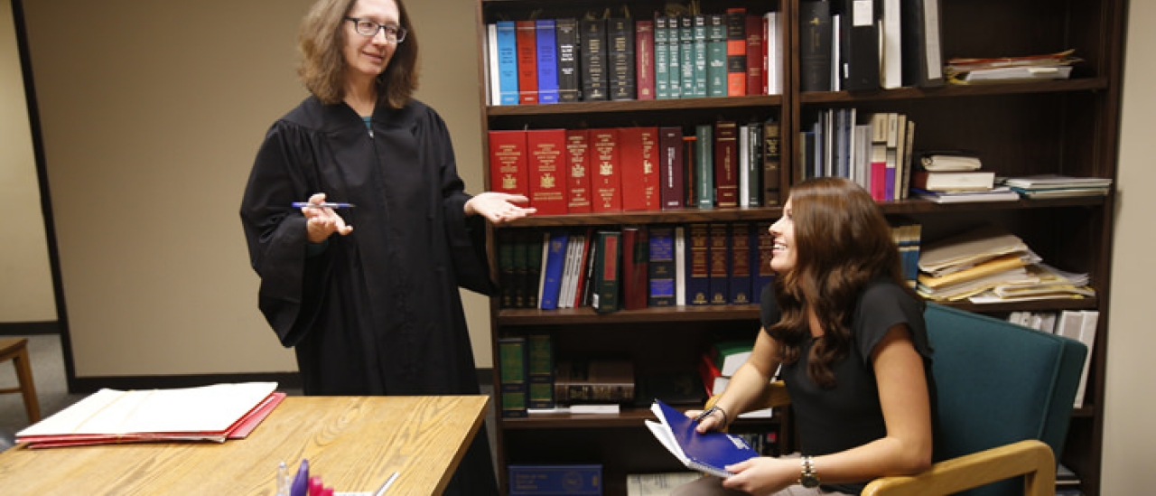 Criminal justice major Alexis Bolesky confers with Judge Lucy Bernier during an internship at Oneonta City Court.