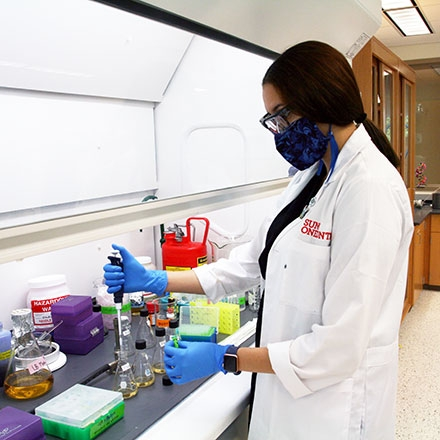 student conducting research in a lab