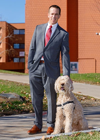Acting President Dennis Craig and his dog Beckett