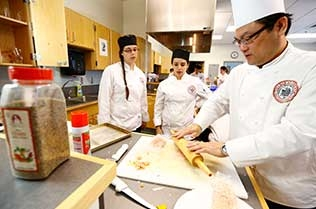 Chef teaching students.