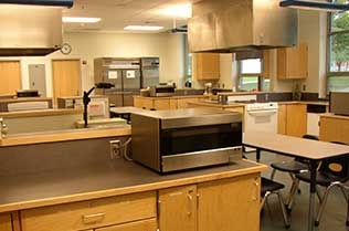 The student kitchen with lots of tables.