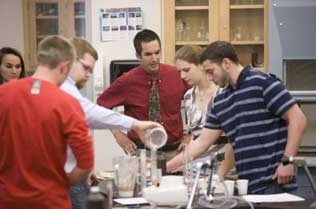 Students testing different foods in a lab.