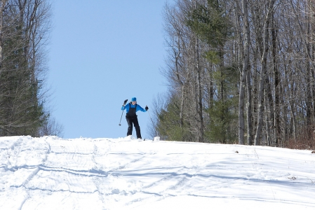 Person skiing on a snowy hill.