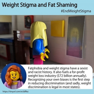 Lego student is looking at her reflection in a mirror.