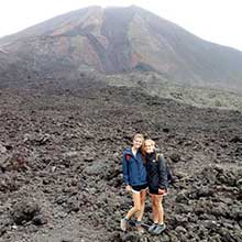 Students in front of volcano