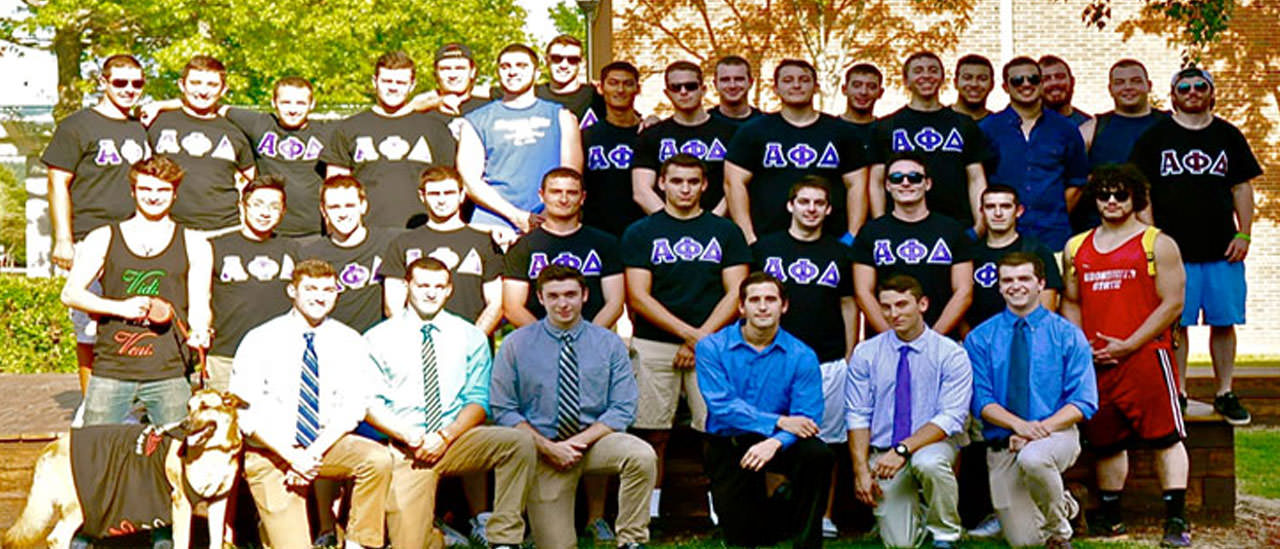 Group of guys from the Alpha Phi Delta fraternity posing for a picture.