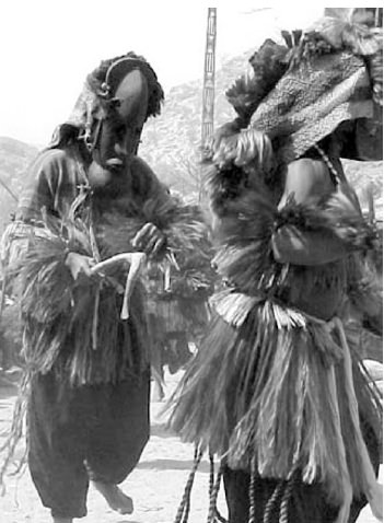 A mask dance celebration was provided for us by the Dogon.