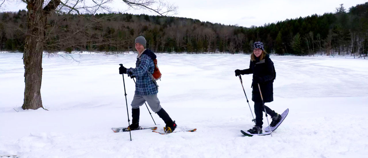 Students try out snowshoeing at Gilbert Lake.