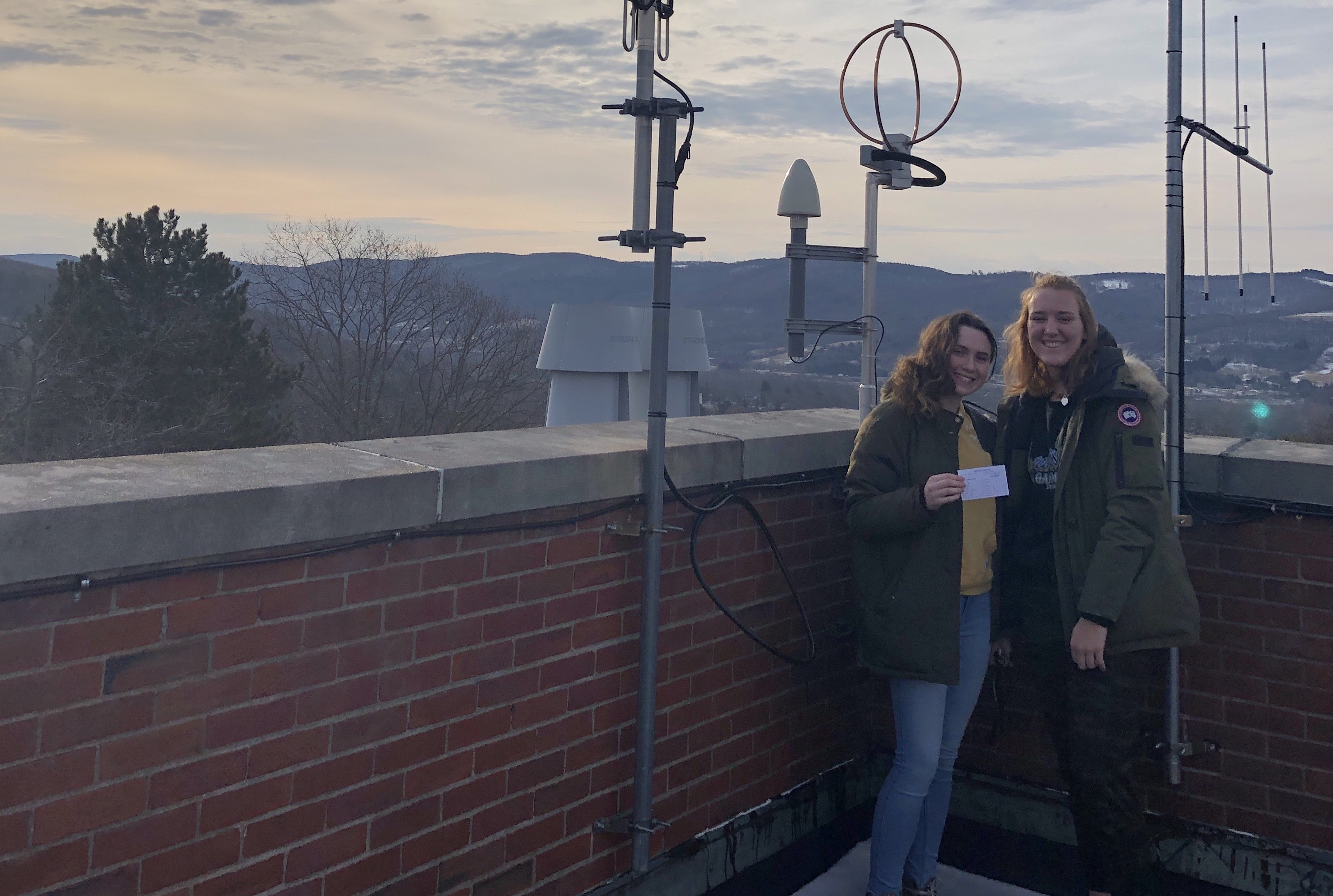 Meteorology majors collecting weather data from the rooftop weather station