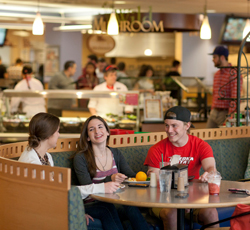 Students enjoying a meal in the dining hall